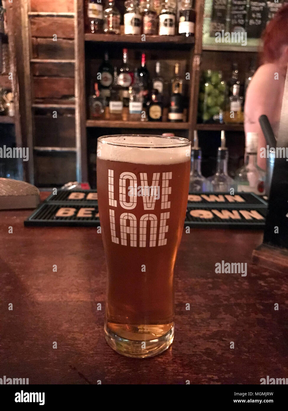 Love Lane Brewery Pint Pot Glass, on a bar - Stock Image