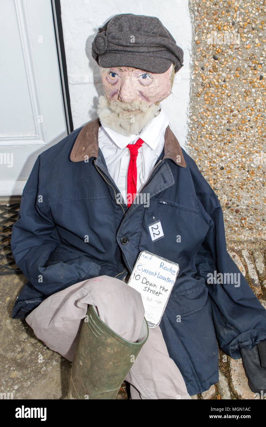 An effigy of leader of the uk labour party Jeremy Corbyn sitting on the floor - Stock Image