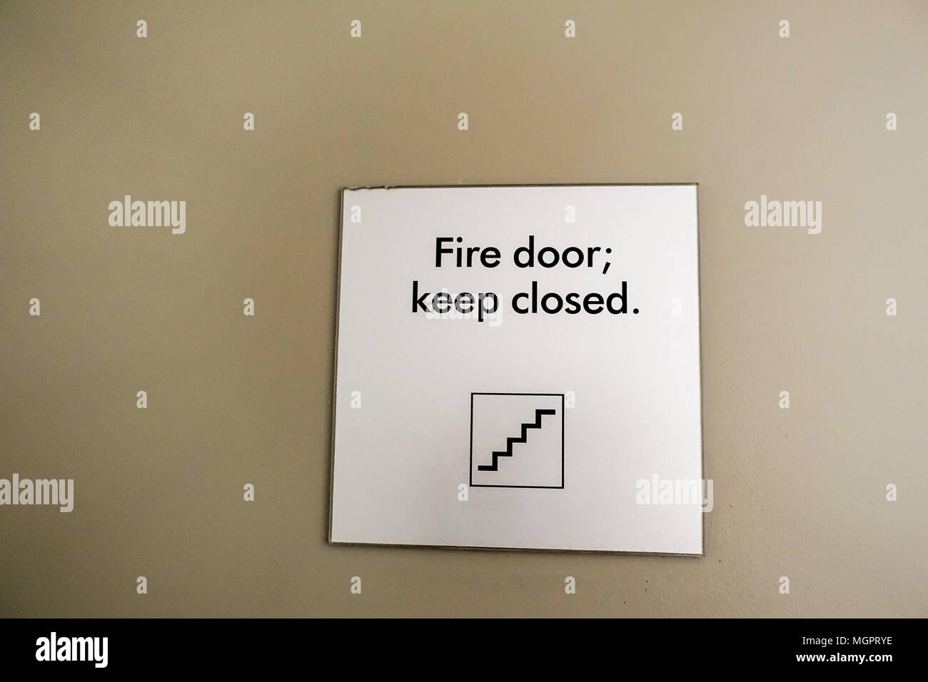 Fire door keep closed sign inside apartment high rise building in Vancouver BC Canada & Fire door keep closed sign inside apartment high rise building in ...