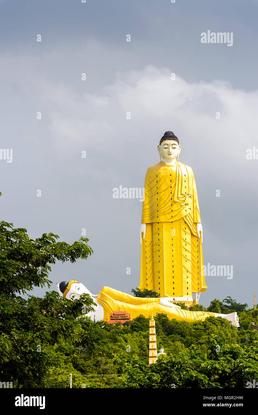 Giant standing Buddha at the Maha Bodhi Ta Htaung, a famous Buddhist region and monastery, Monywa Township, Sagaing Area, Myanmar (Burma) - Stock Image