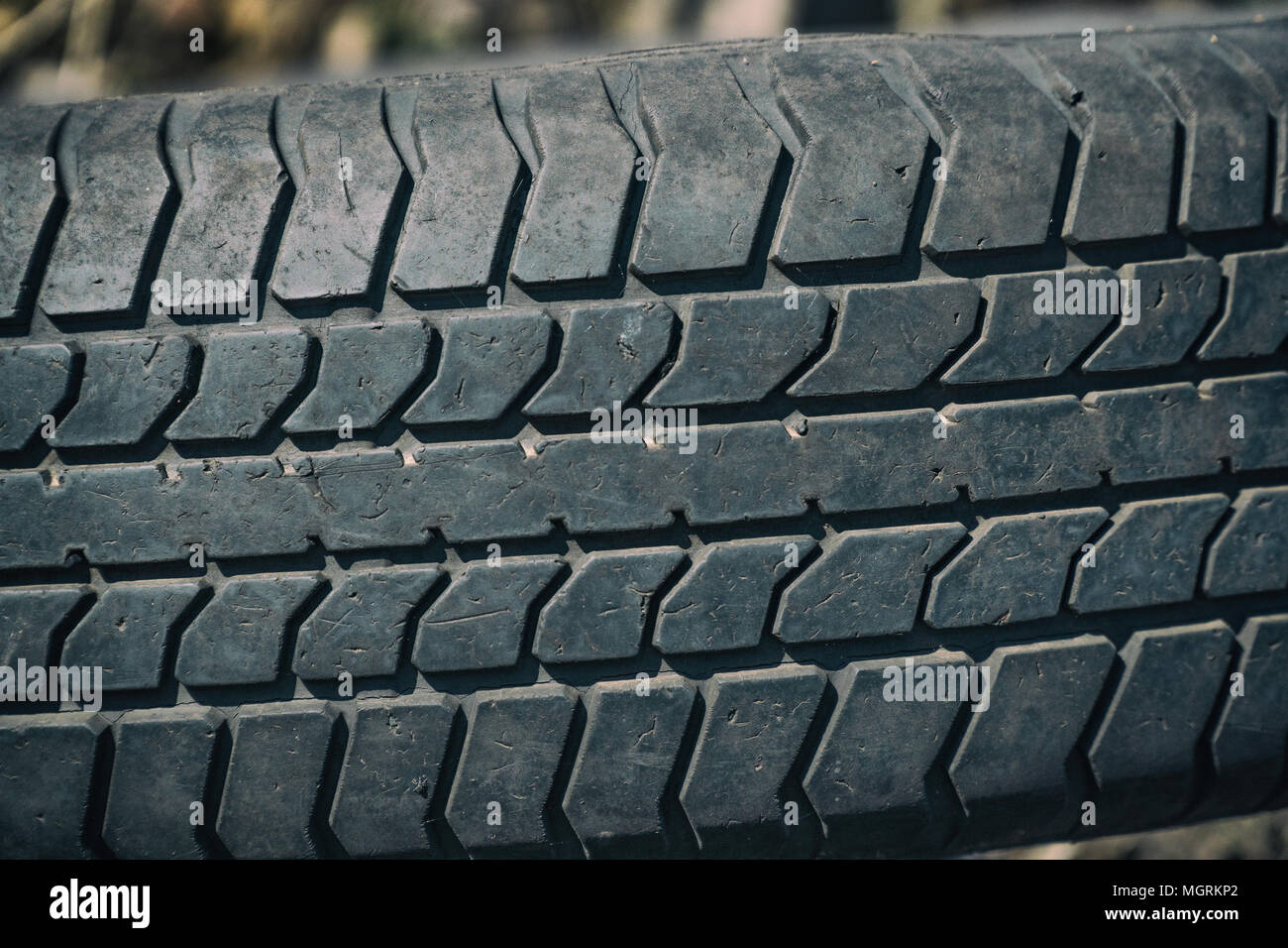 Old worn tire with a worn tread - Stock Image