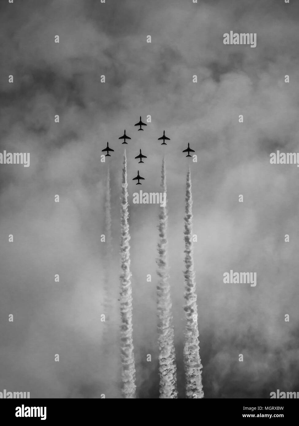 Airplanes in formation during an airshow - Stock Image