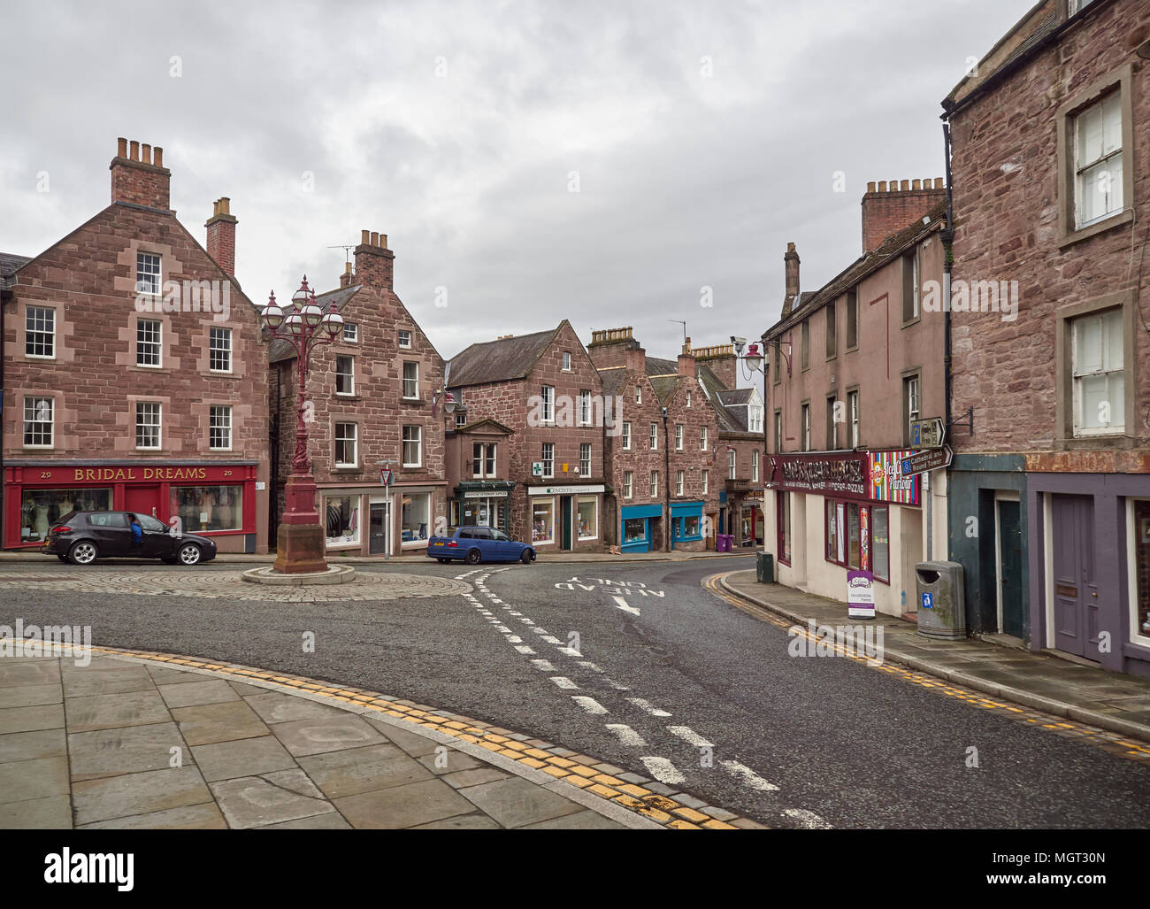 Looking towards the High Street from Church Street, with parked cars and shops closing on a Saturday afternoon in Brechin, Angus, Scotland. - Stock Image