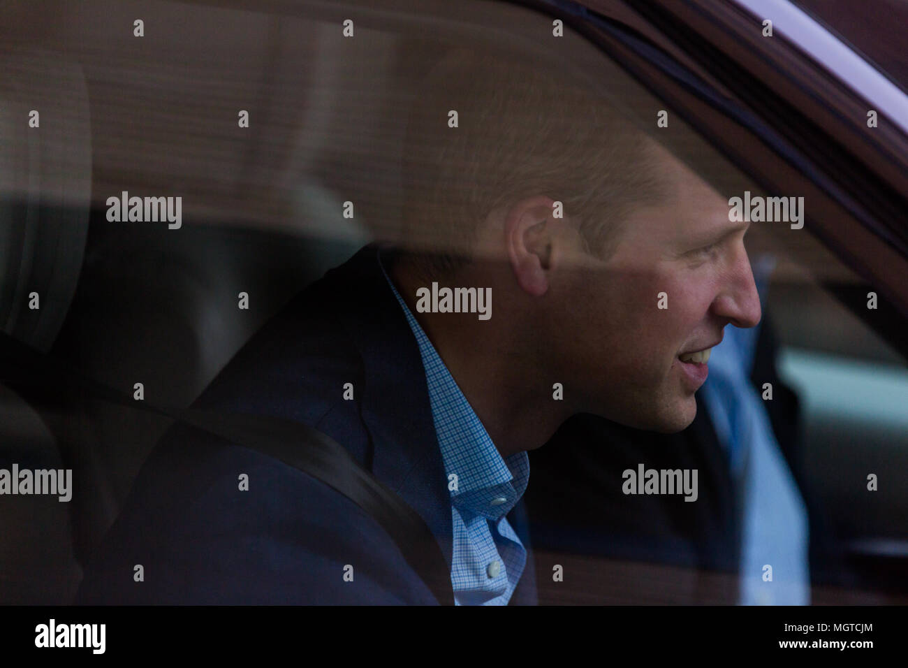 HRH Prince William, The Duke of Cambridge driving his family home from the Lindo Wing following the birth of his third child. - Stock Image