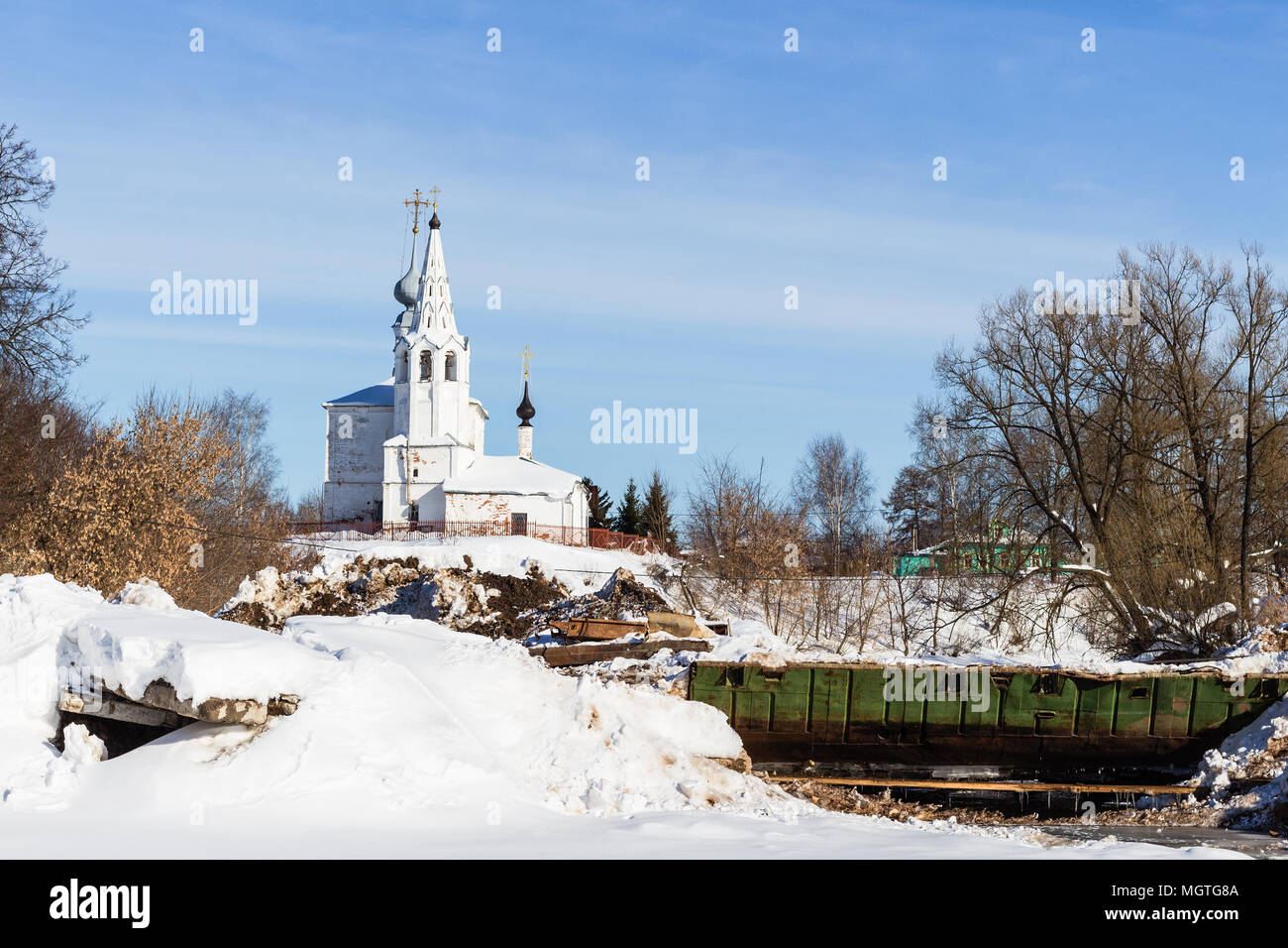 view of Temple of St Cosmas and St Damian (Kozmodemyanskaya Church) on Yarunova Hill from ravine in Suzdal town in winter in Vladimir oblast of Russia - Stock Image