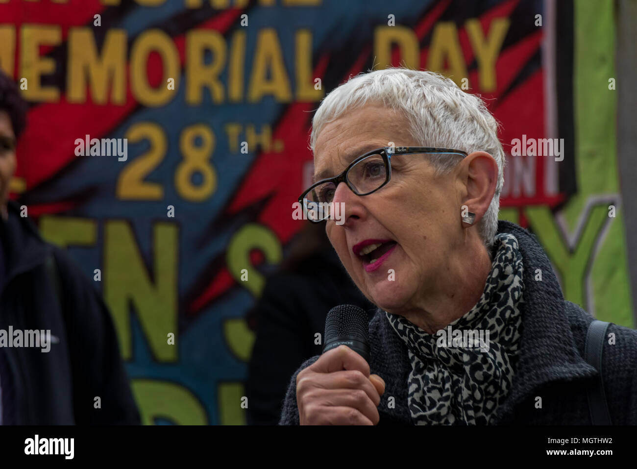 London, UK. 28 April 2018.  Gail Cartmel, Assistant General Secretary Unite, speaks at the International Workers' Memorial Day rally at the statue of a building worker on Tower Hill remembering all those killed at work, around 500 in the last ten years, mainly in the construction industry, as well as those injured, disabled and made unwell, almost all in preventable incidents. Credit: ZUMA Press, Inc./Alamy Live News - Stock Image