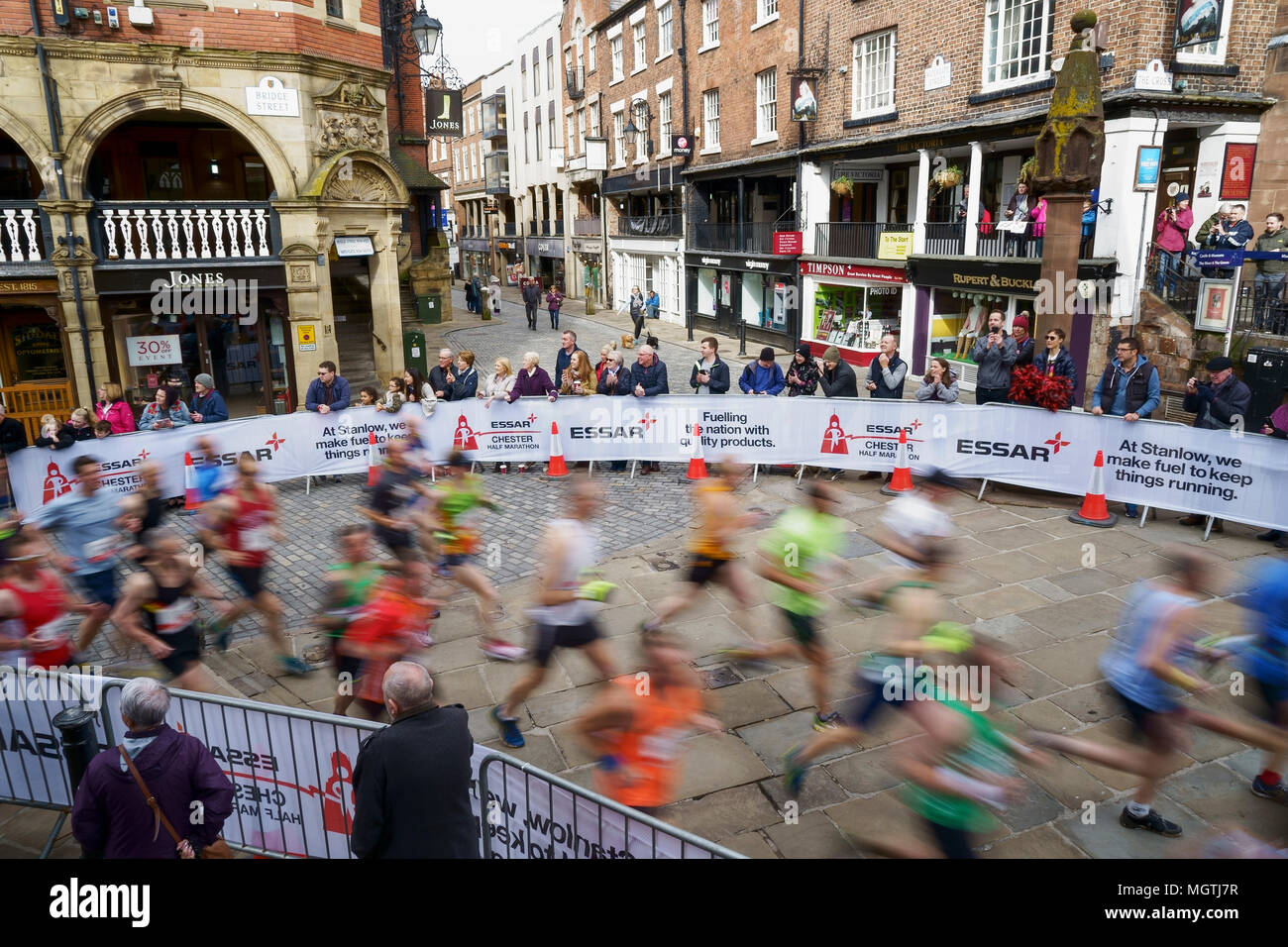 Chester, UK. 29th April 2018. Runners in the early stages of the Essar Chester Half Marathon run through the streets of Chester city centre. Credit: Andrew Paterson/Alamy Live News - Stock Image