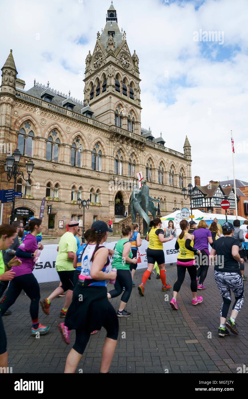 Chester, UK. 29th April 2018. Runners in the early stages of the Essar Chester Half Marathon run through the streets of Chester city centre past the Town Hall. Credit: Andrew Paterson/Alamy Live News - Stock Image