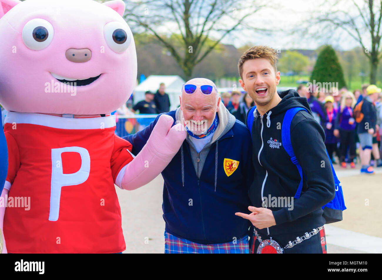 Glasgow, Scotland, UK. 29th April, 2018. Kiltwalk Glasgow 2018, a charity event where walkers have three distances to choose from, a Mighty Stride (23 miles), a Big Stroll (14 miles) or the Wee Wander (6 miles). This year involved 10,000 walkers and raised two million pounds for 600 charities. Pictured Pigby, Sir Tom Hunter and Sean Batty. Credit: Skully/Alamy Live News - Stock Image