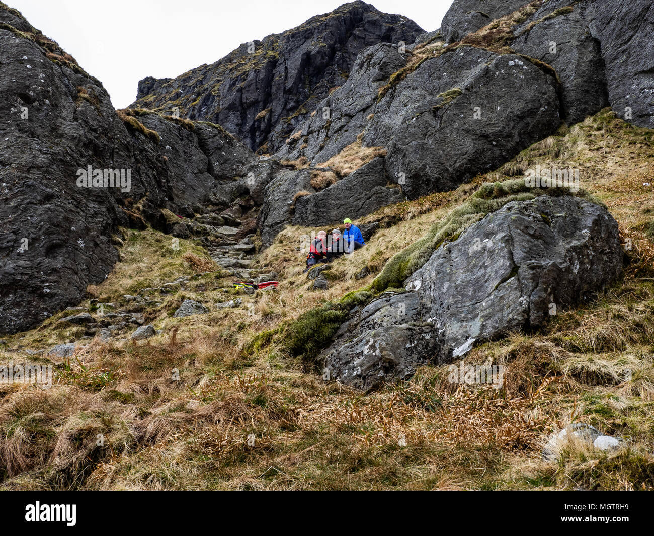 Ben Arthur, The Cobbler, Scotland 29th April 2018. A coastguard helicopter dropping off mountain rescue team members to help an injured walker who was later carried off the hill. Credit: george robertson/Alamy Live News - Stock Image