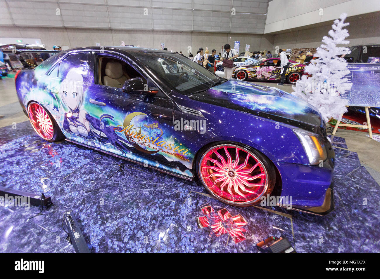 a car decorated with anime decals itasha on display at niconico