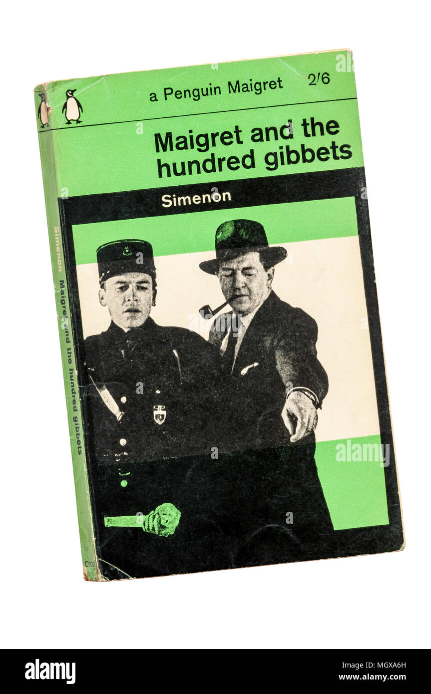 Green Penguin Maigret published 1963. Maigret and the Hundred Gibbets first published in French as Le Pendu de St Pholien in 1931. - Stock Image