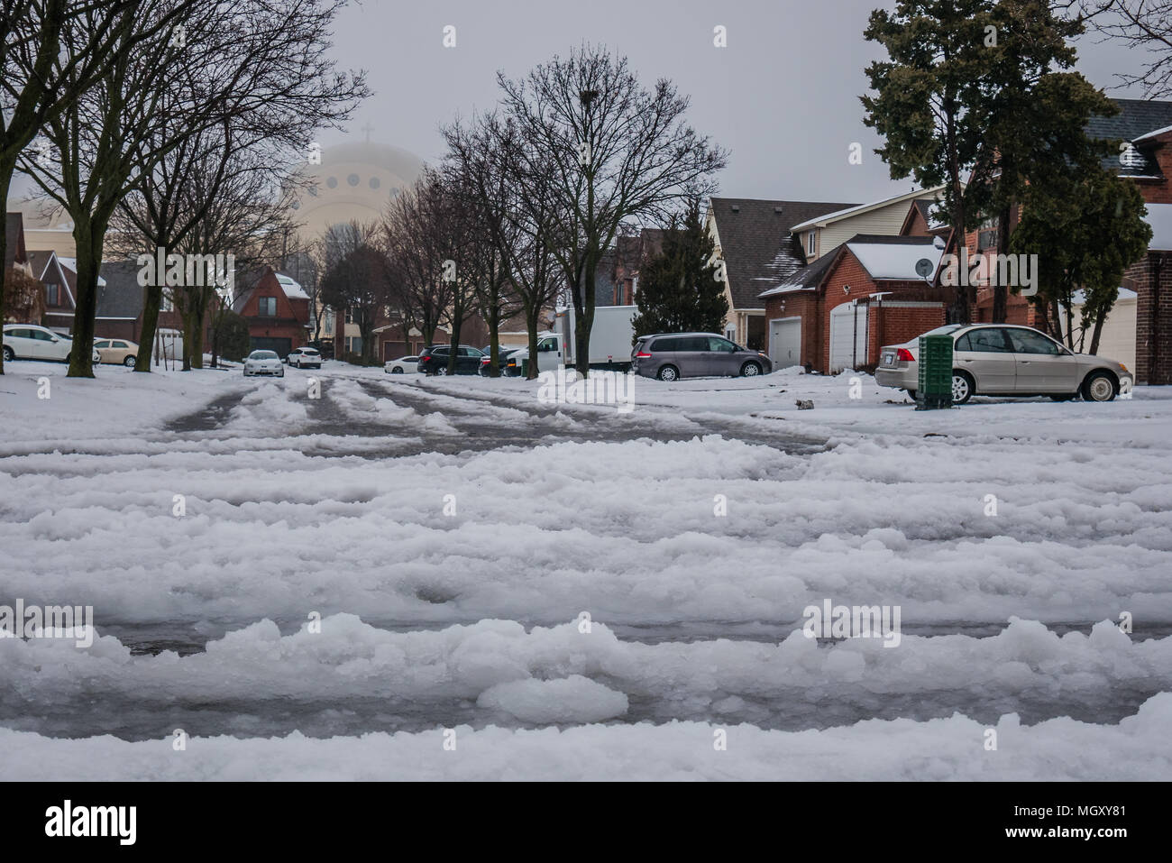 Slushy ice and snow creating a dangerous driving condition during Canadian winter - Stock Image
