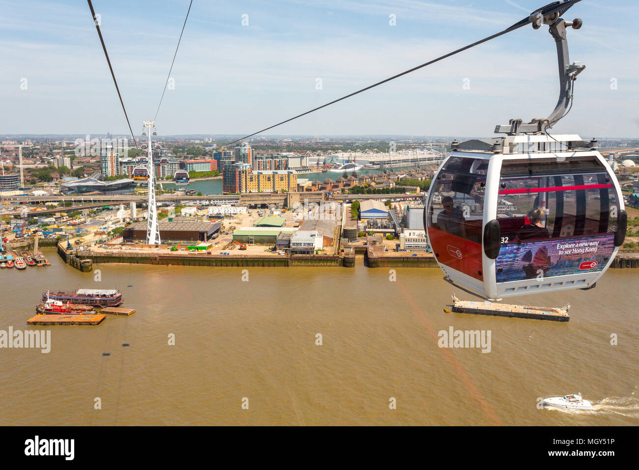 London, United Kingdom - June 11, 2015: Flying high over east London on a cable car.  The Emirates Air Line provides fantastic scenic views of London. - Stock Image