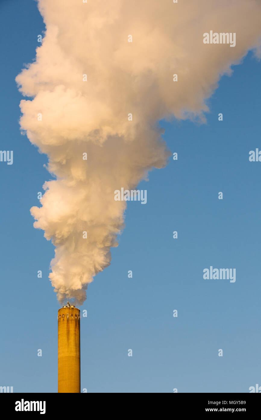 Smoking chimney against blue sky,Munkkisaari,Helsinki,Finland,Europe - Stock Image