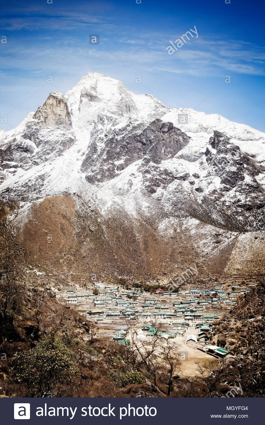 Mt Khumbila rises above the village of Khumjung which was largely funded by a foundation founded by Sir Edmund Hillary. Nepal. - Stock Image