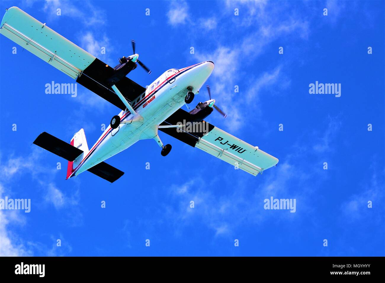 MAHO, ST MAARTEN - FEBRUARY 27TH 2018: A Winair plane coming in to land at Princess Juliana International Airport. Shot was taken from the beach below - Stock Image