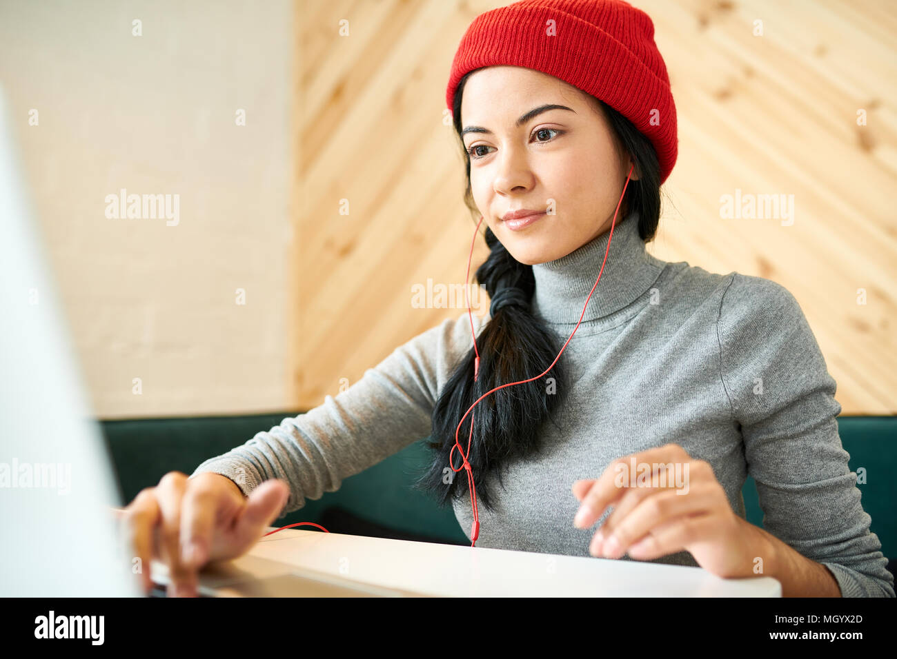 Young Woman Blogging in Cafe - Stock Image