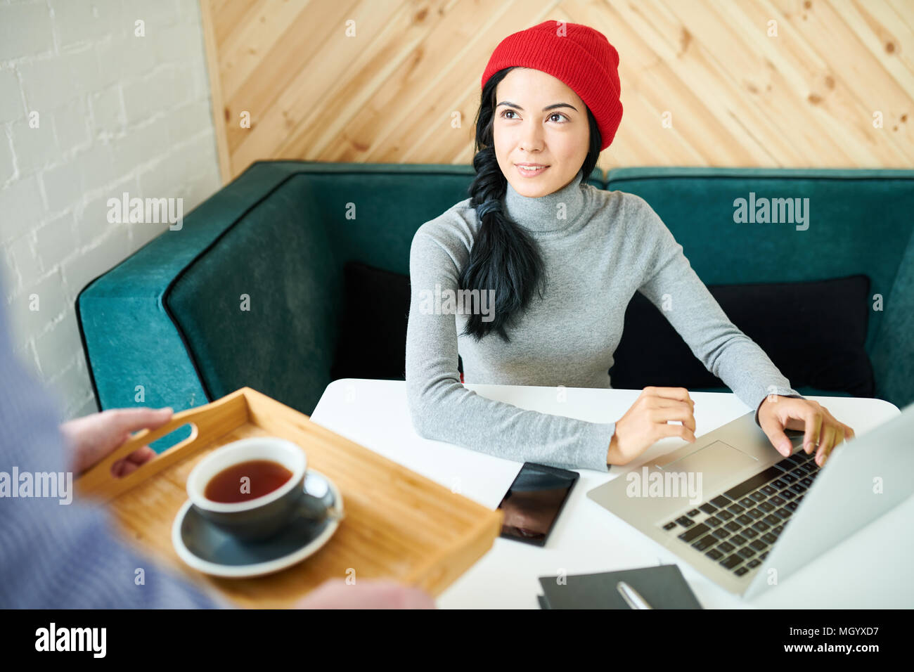 Pretty Woman Working in Cafe - Stock Image