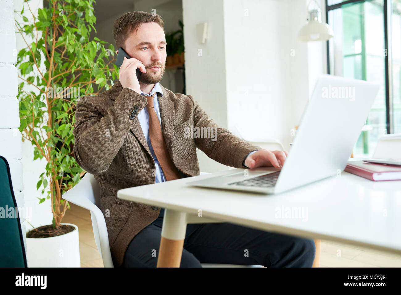 Successful Businessman Working in Cafe - Stock Image