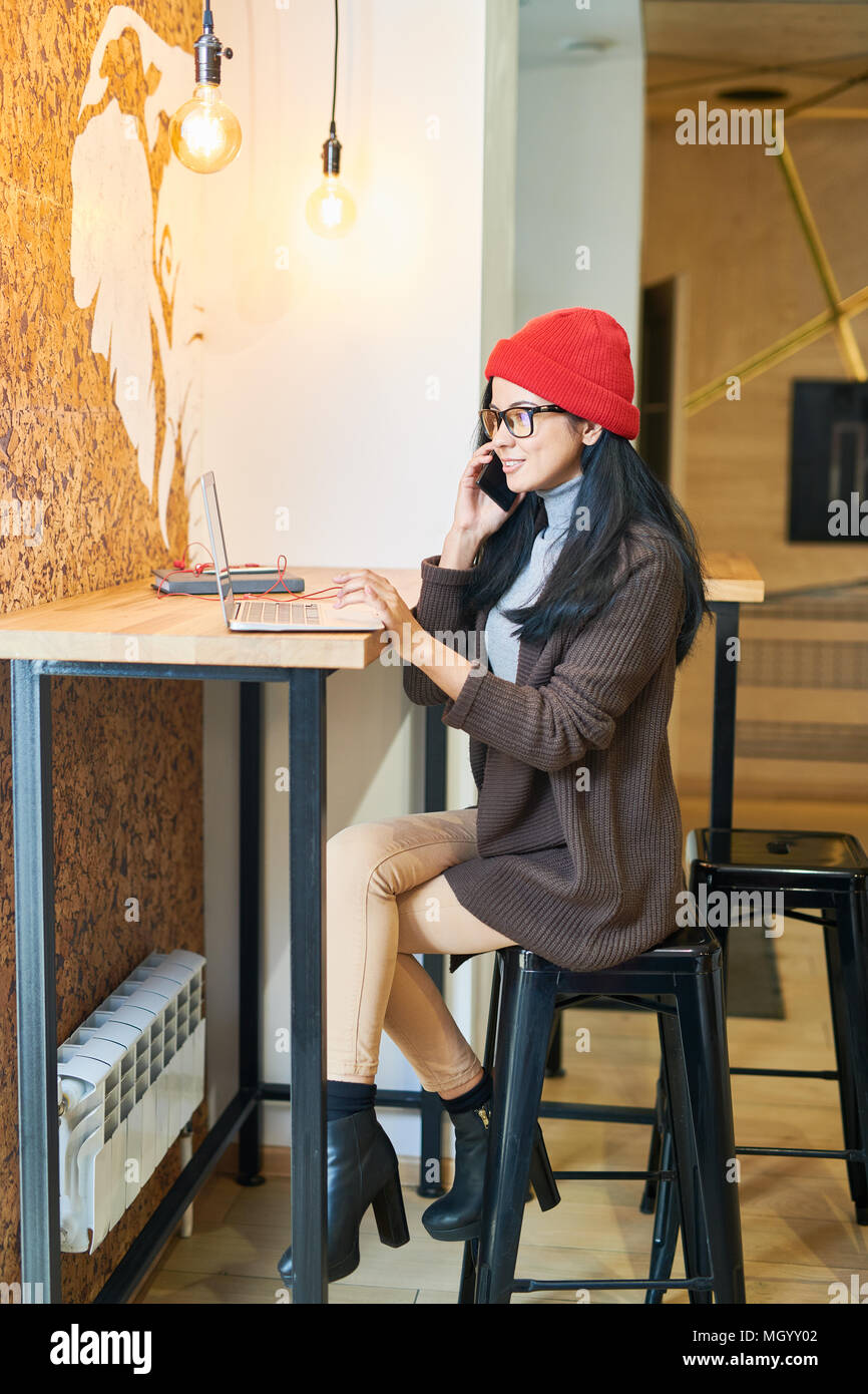 Contemporary Woman Working in Cafe - Stock Image