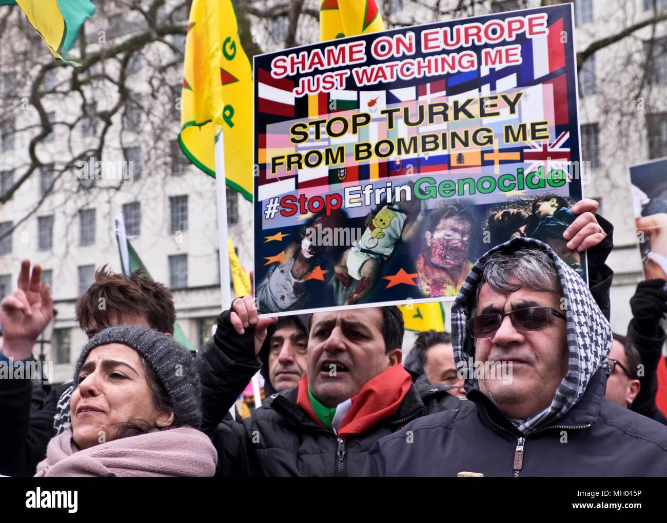 Kurdish men and  women protesting genocide in Afrin in Syria on Stand up against Racism, International demonstration in London to mark UN anti-racism day. March 17 2018 - Stock Image
