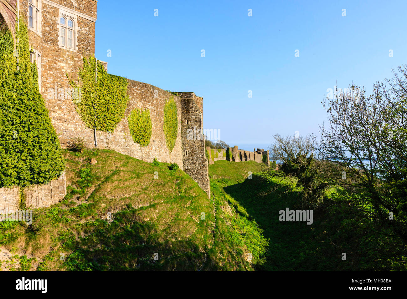 England, Dover castle. Outer Western curtain wall from the Constable's gate showing Queen Mary's tower and others in the distance. Bright sunshine. Stock Photo