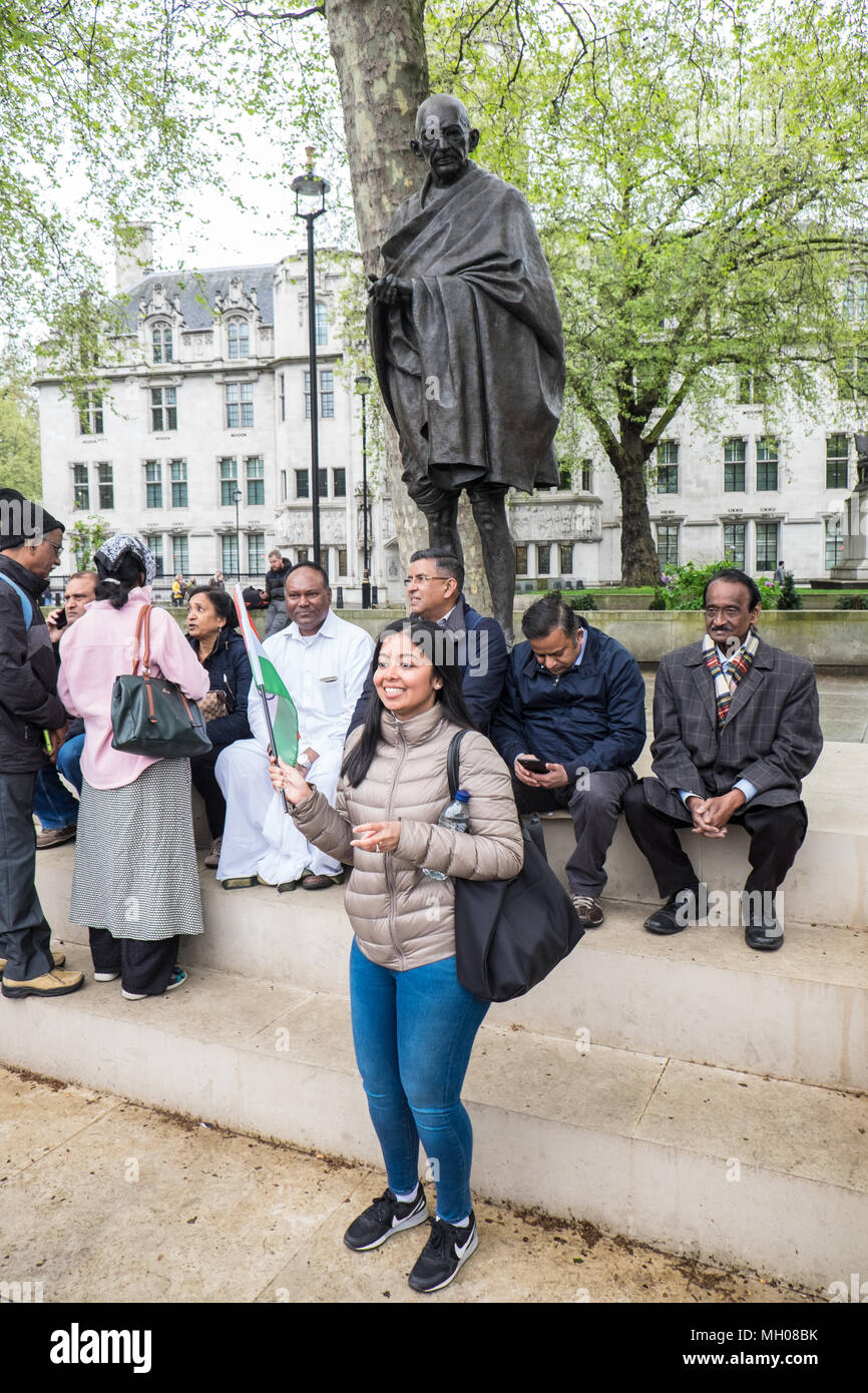 Indian,flag,peaceful,demonstration,Mahatma Gandhi,Gandhi's,bronze,statue,in,Parliament,Square,opposite,Houses of Parliament,London,Great Britain,GB, - Stock Image