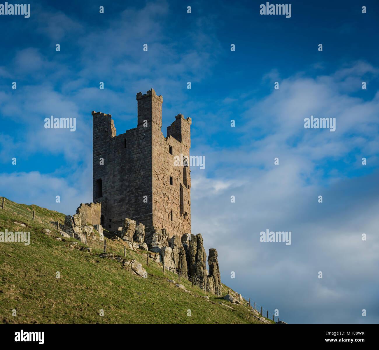 Lilburn Tower, Dunstanburgh Castle, Northumberland, UK. - Stock Image