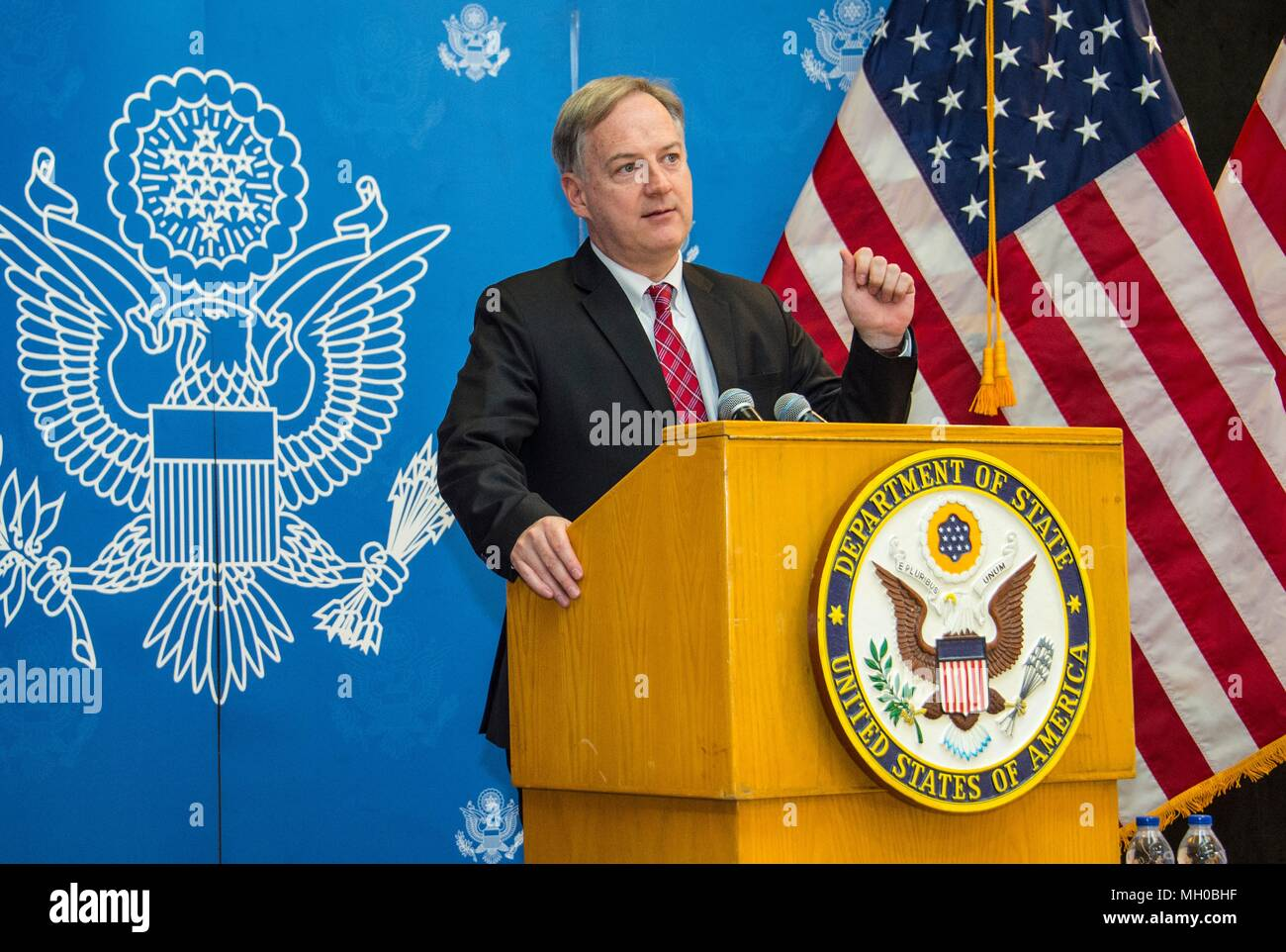 U.S. Embassy Chargé d'Affaires Christopher Henzel introduces U.S. Secretary of State Mike Pompeo, before he delivers remarks to staff and families from U.S. Embassy Riyadh April 29, 2018 in Riyadh, Saudi Arabia. - Stock Image