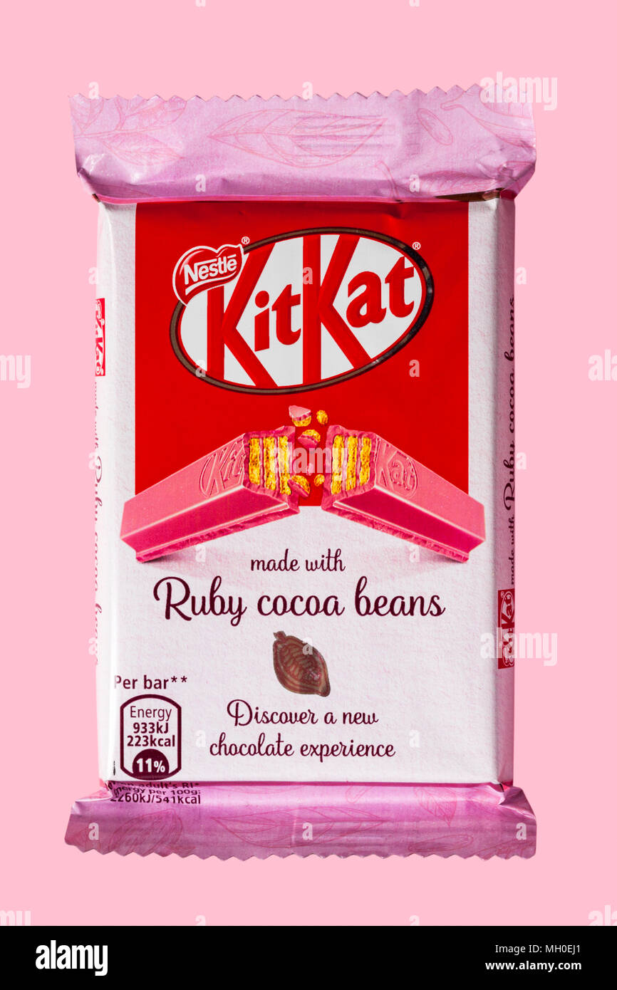 Bar of Kitkat Kit-Kat Kit Kat made with ruby cocoa beans isolated on pink background - discover a new chocolate experience - Stock Image