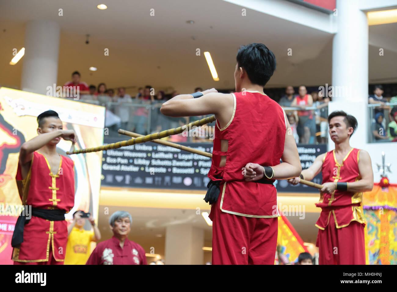 Chinese traditional stuntman performing his stunts at VIVA HOME shopping mall in Kuala Lumpur, Malaysia. - Stock Image