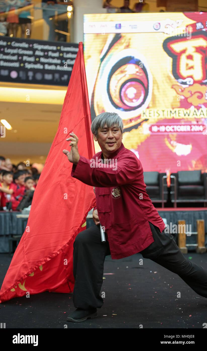 Chinese traditional stuntman master performing his stunts at VIVA HOME shopping mall in Kuala Lumpur, Malaysia. - Stock Image