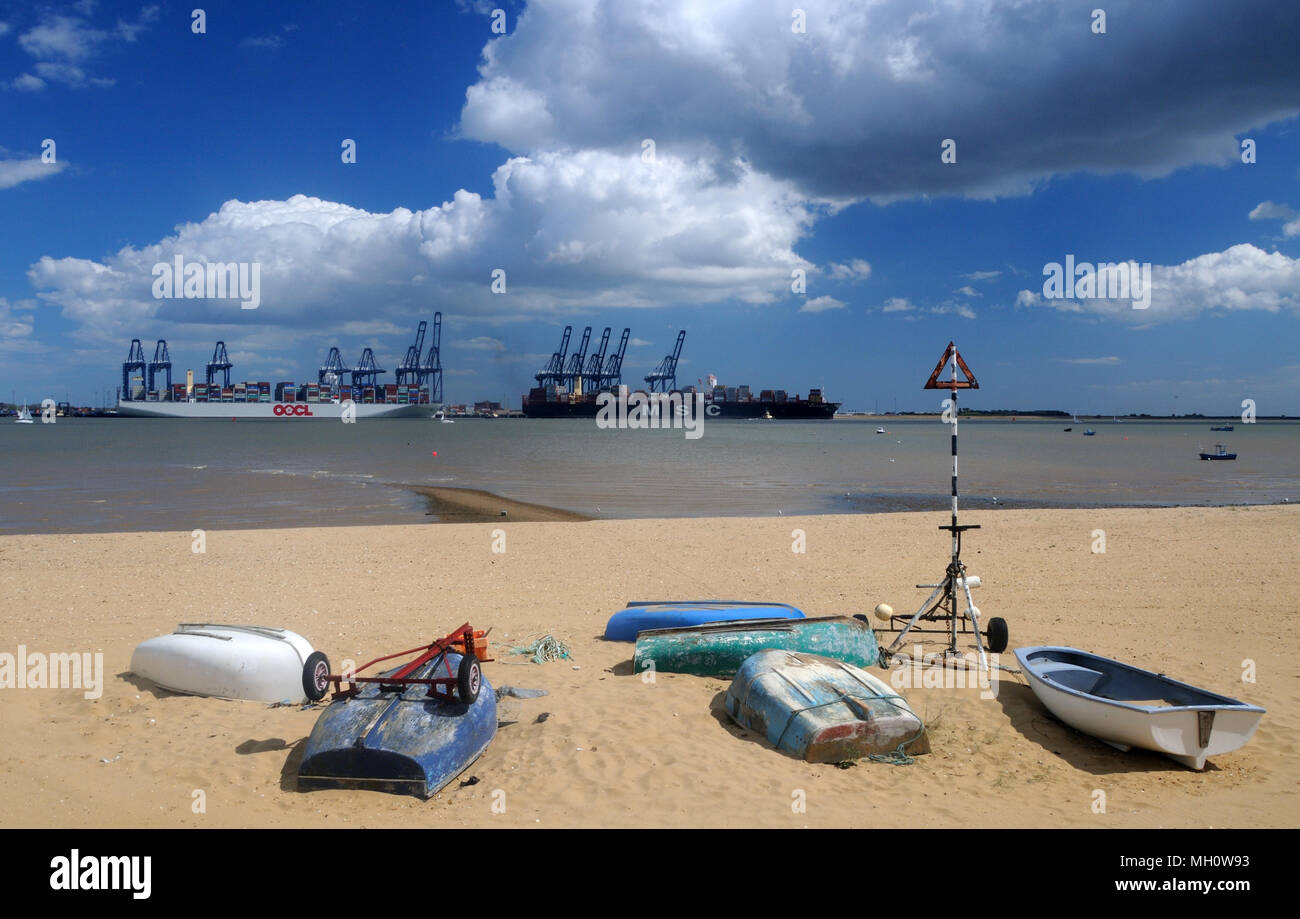 Container ships loading at Felixstowe, from the beach at Harwich, Essex, England - Stock Image