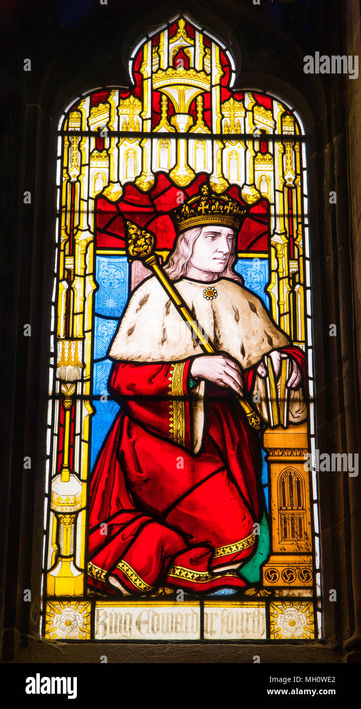 Stained glass depicting King Edward the Fourth with crow and scepter. St Laurence's church Ludlow Shropshire UK. April 2018 Stock Photo