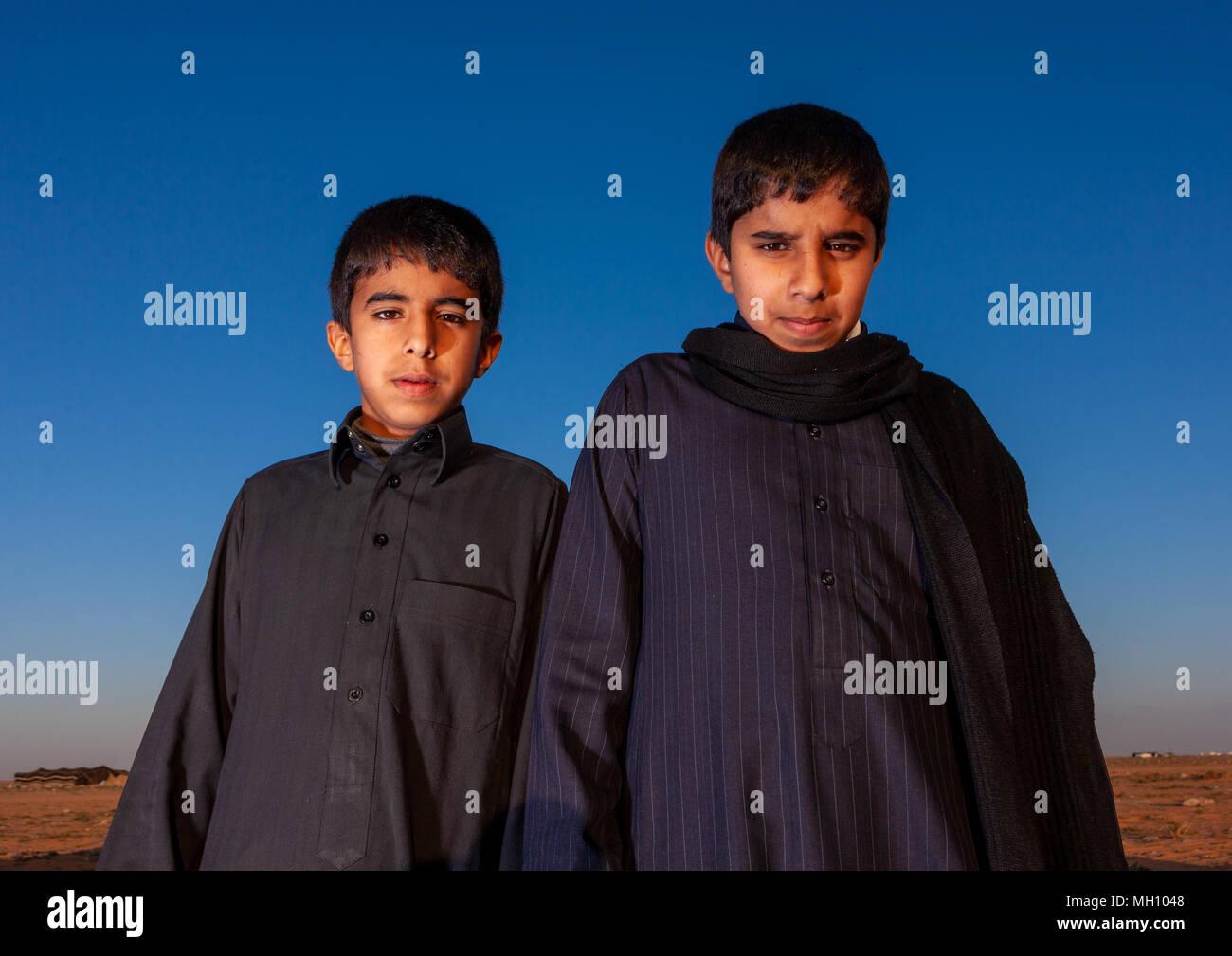 Portrait of two saudi boys, Al Madinah Province, Al-Ula, Saudi Arabia Stock Photo
