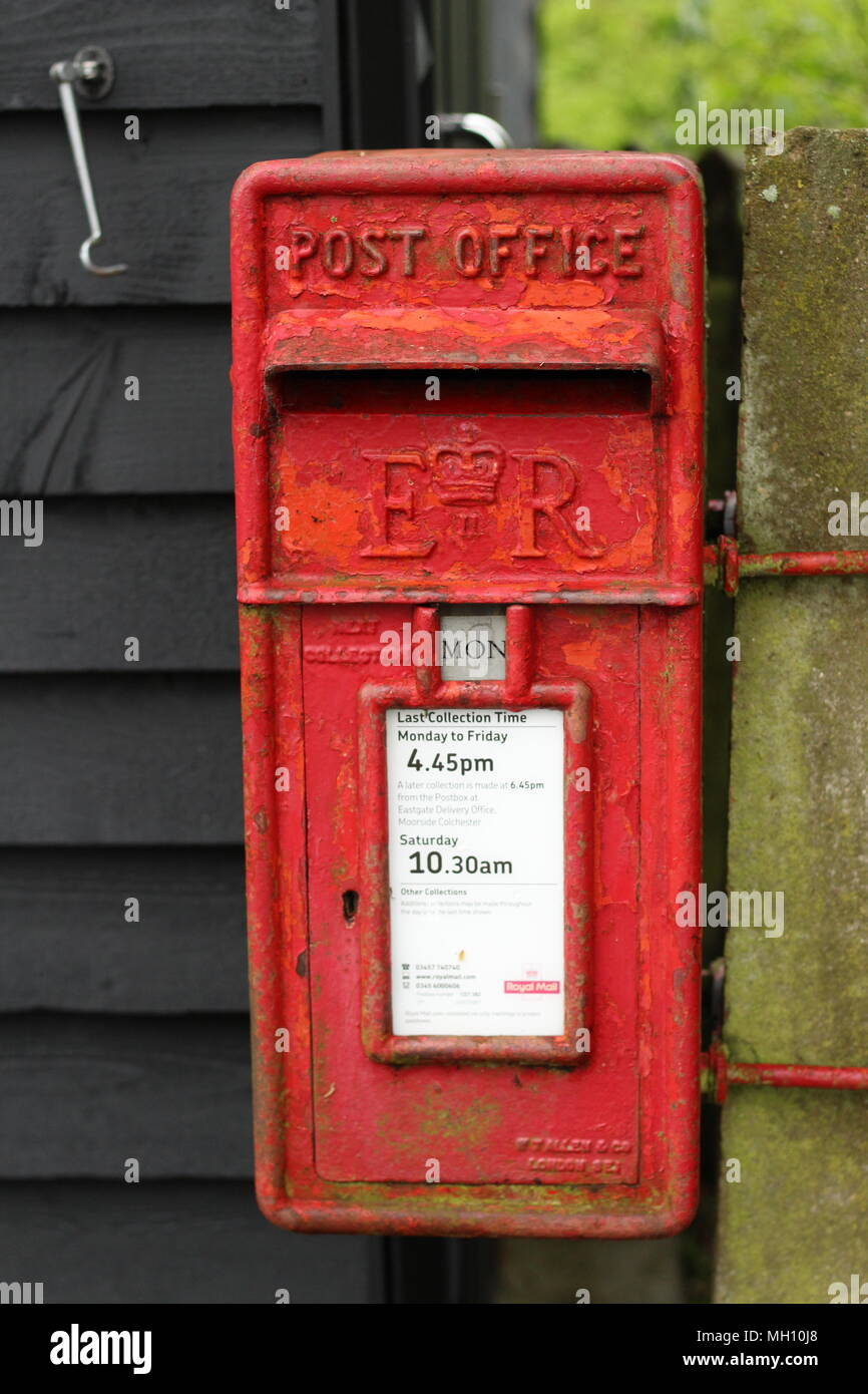 Postal Services - An old English Postbox, Suffolk, UK. - Stock Image
