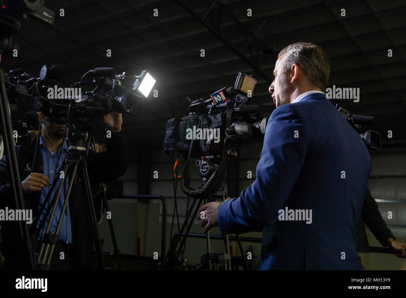 Washington Township, Michigan USA - A television reporter broadcasts live from President Donald Trump's campaign rally in Macomb County, Michigan. - Stock Image