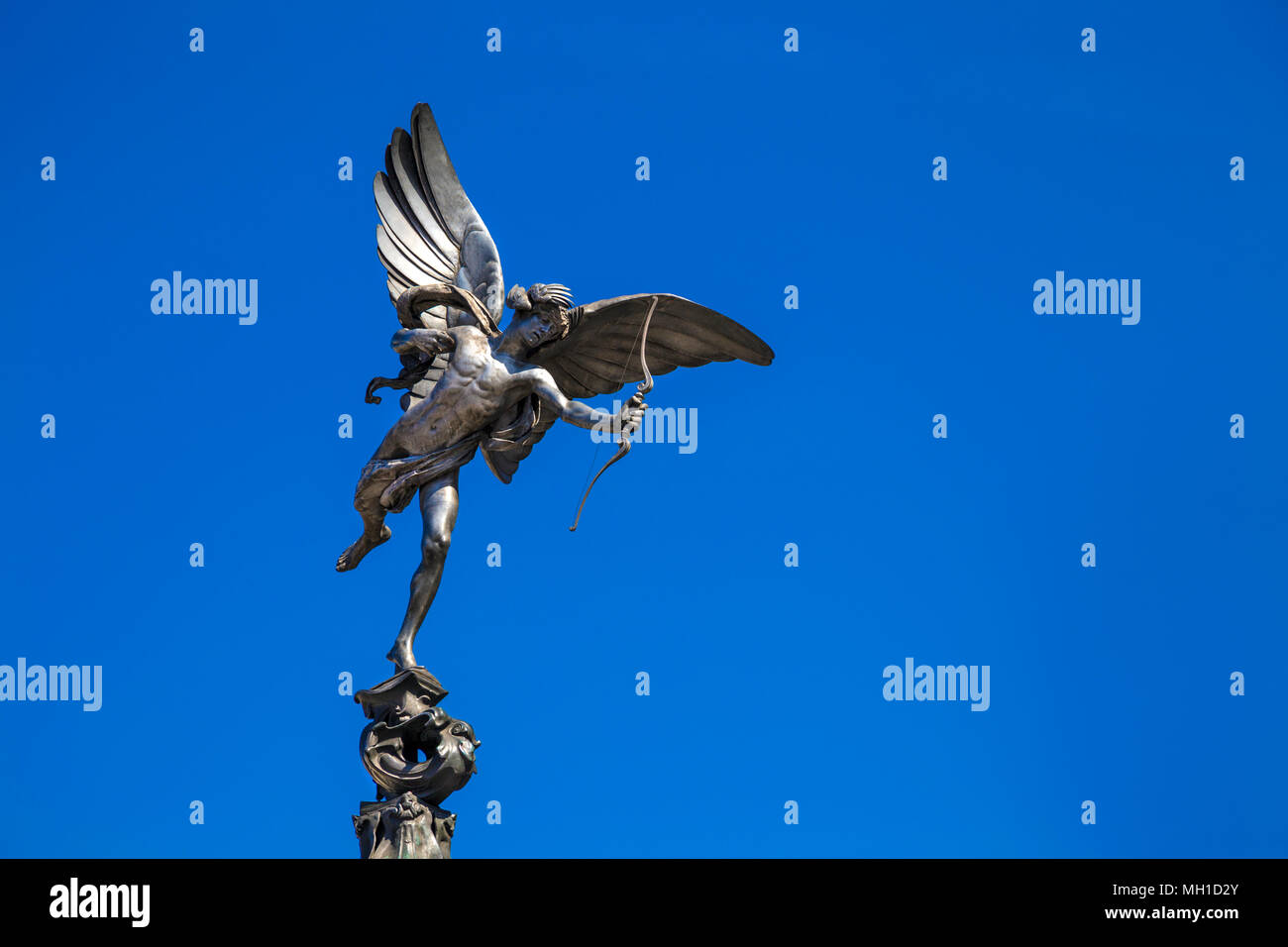 Statue of the Greek god Anteros by Alfred Gilbert on top of the Shaftesbury Memorial Fountain in Piccadilly Circus, London, UK - Stock Image