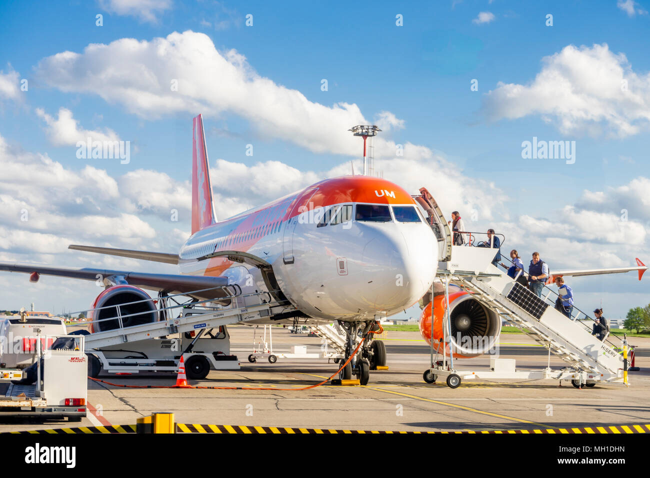 Passengers boarding an Easyjet Airbus A320-200 aircraft/ airplane by stairs at Schoenefeld Airport (SXF) in April 2018 - Stock Image