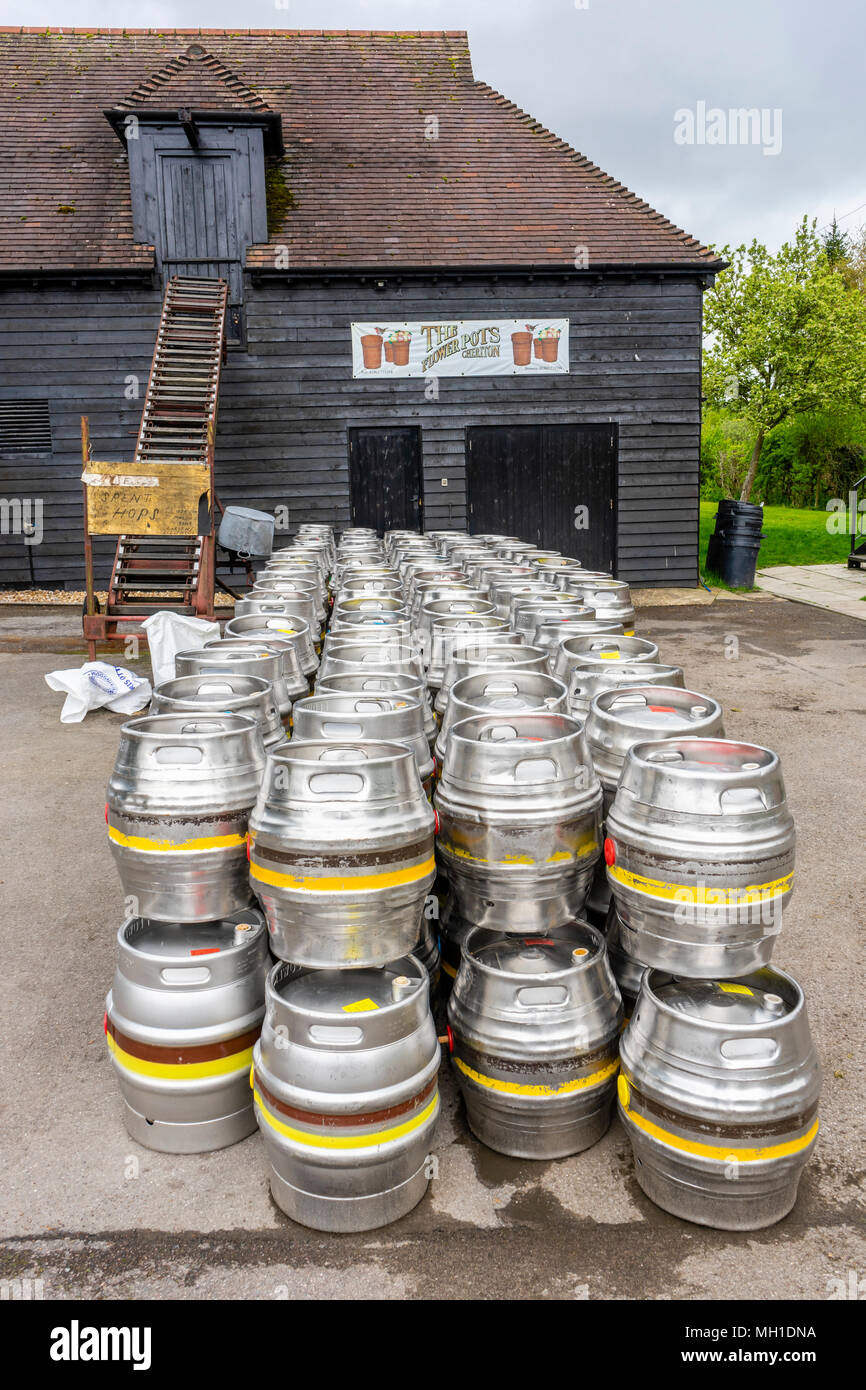 Rows of aluminium beer barrels outside the Flower Pots Brewery in the H&shire village of Cheriton 2018 England UK & Rows of aluminium beer barrels outside the Flower Pots Brewery in ...