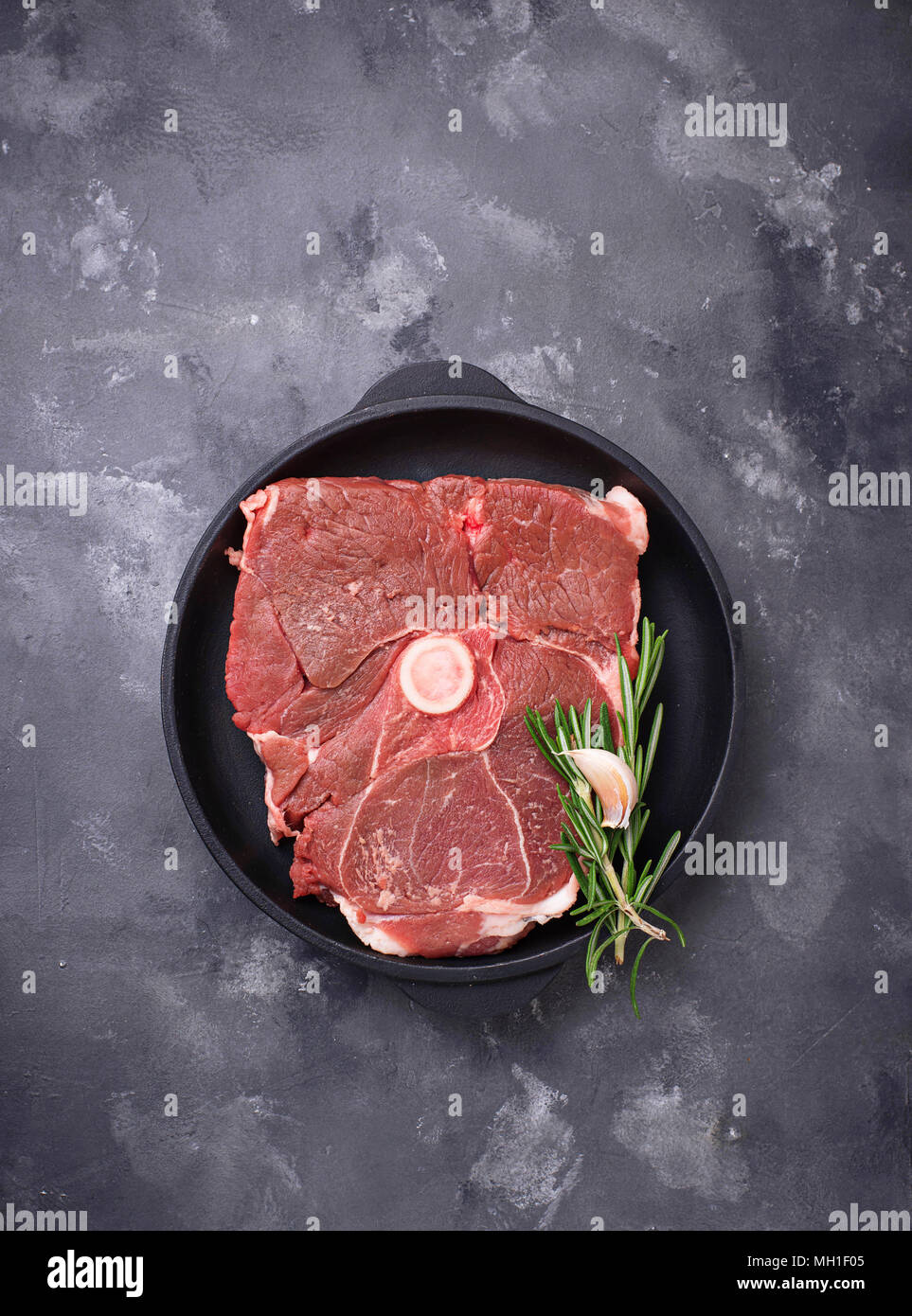 Lamb meat with rosemary and spices - Stock Image