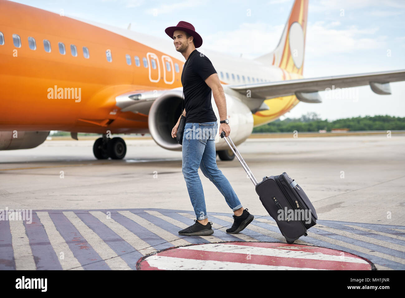 Young guy in airport - Stock Image