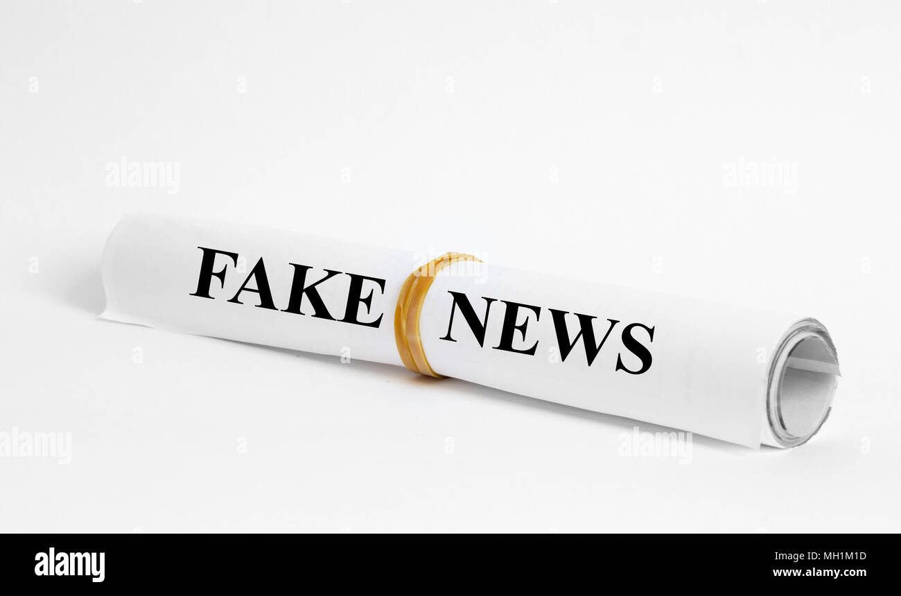 fake news headline in newspaper - Stock Image