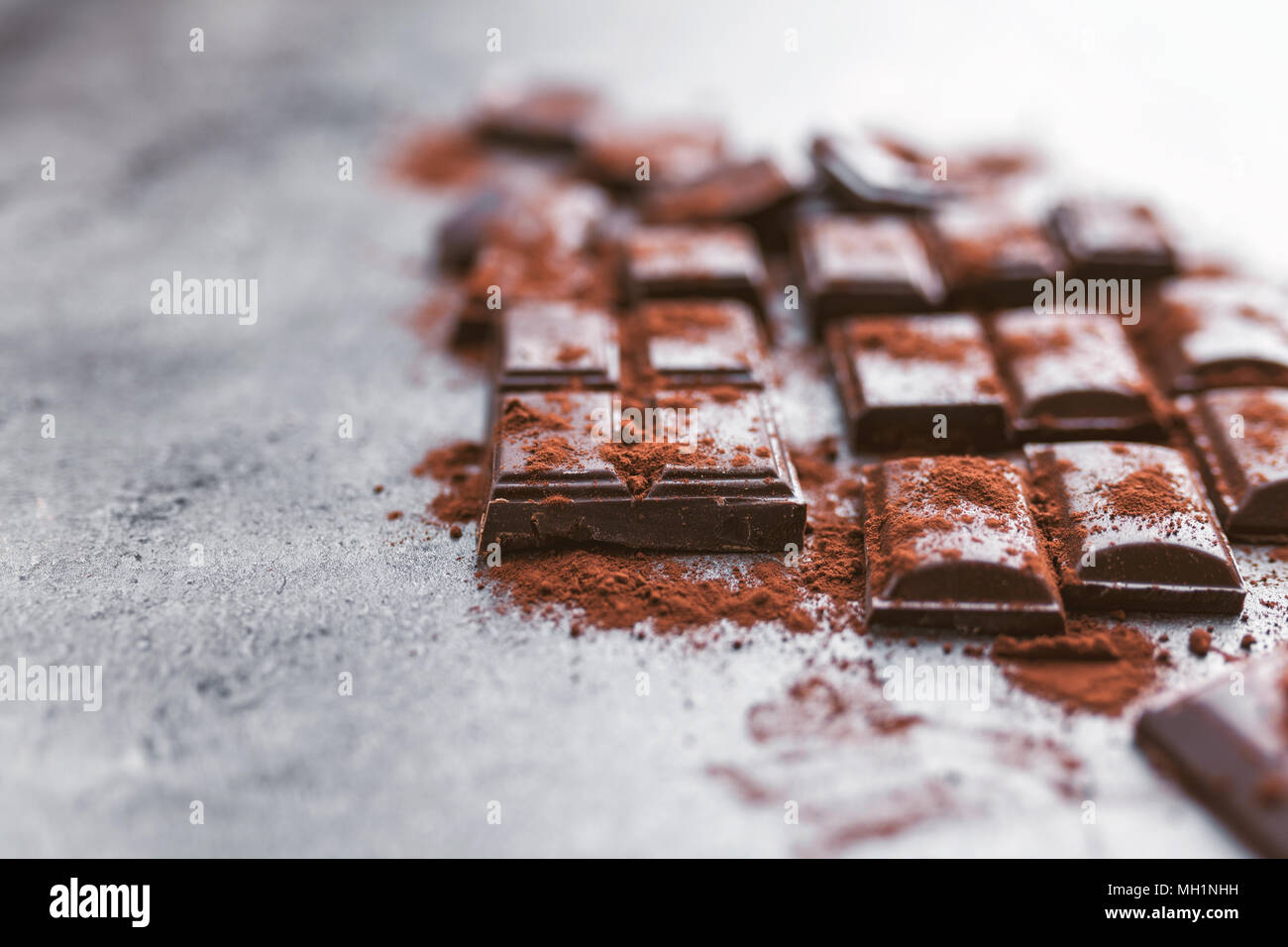 Delicious dark chocolate with cocoa porwder - Stock Image