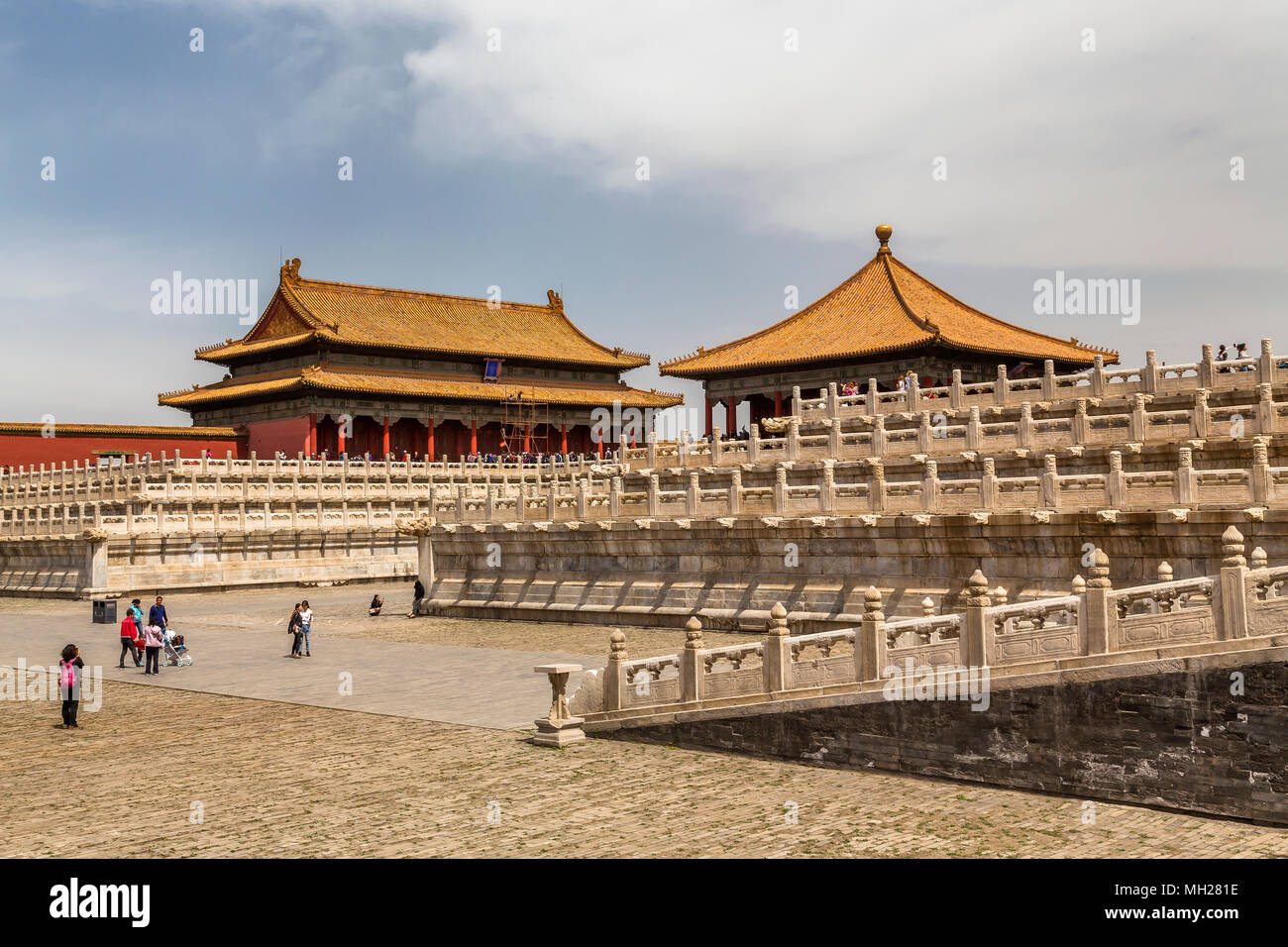 Above a marble three tiered terrace stands the Hall of Central Harmony with the Hall of Preserving Harmony behind. Forbidden City, Beijing, China. - Stock Image