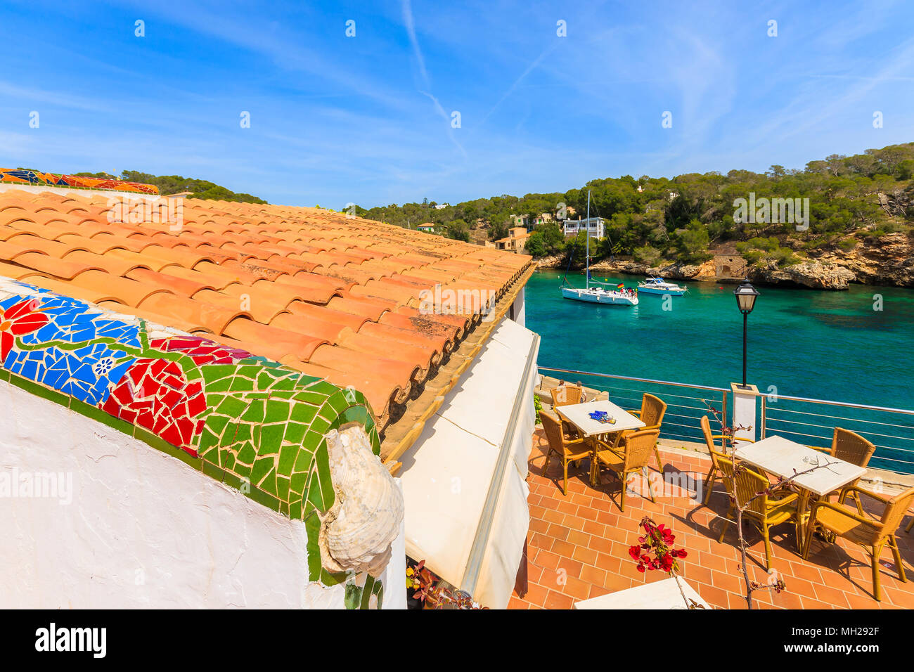 CALA FIGUERA BAY, MAJORCA ISLAND - APR 16, 2013: Tables on terrace of coastal restaurant located in beautiful village. Balearic islands are most visit - Stock Image