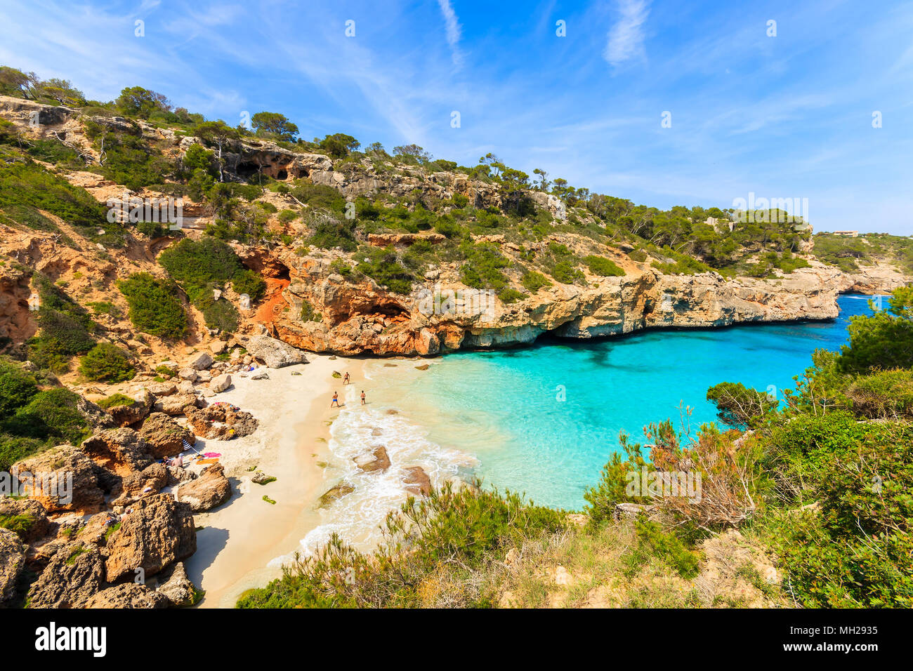 Unidentified people playing on beach, Cala des Moro, Majorca island, Spain - Stock Image