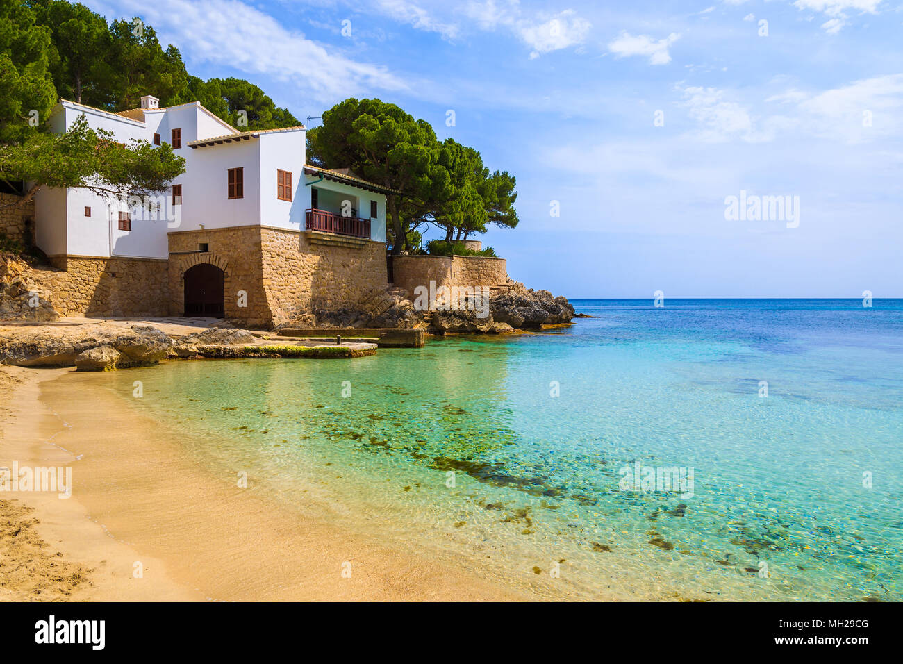 View of beautiful Cala Gat bay with beach and house on shore, Majorca island, Spain - Stock Image