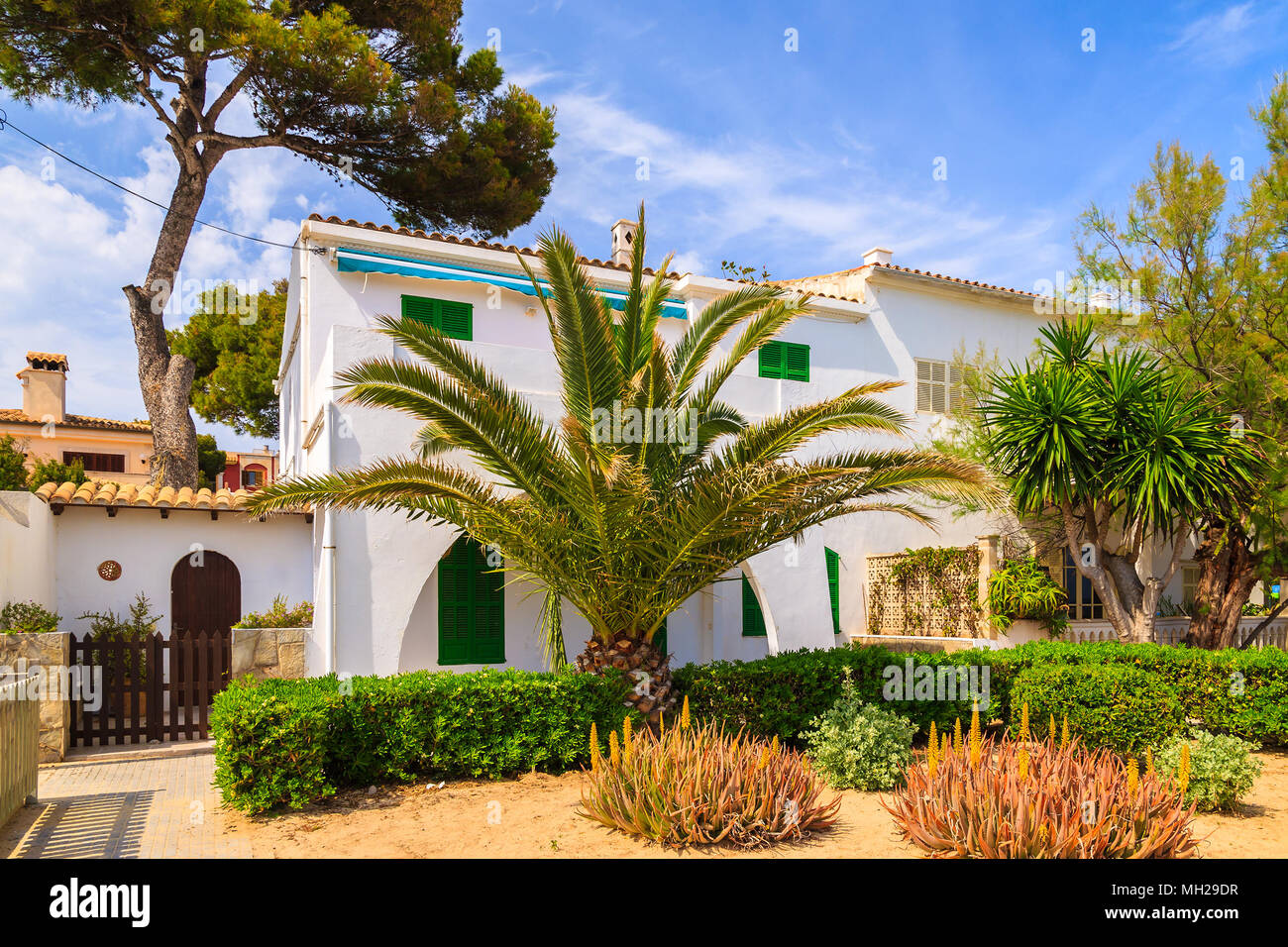 Typical houses in small village on coast of Majorca island near Cala Ratjada, Spain - Stock Image
